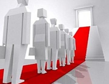 29. Cómo se determina el nivel de empleo y salarios en una economía
